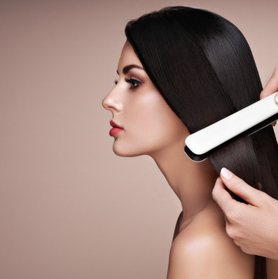 hairdresser-straightening-long-hair-with