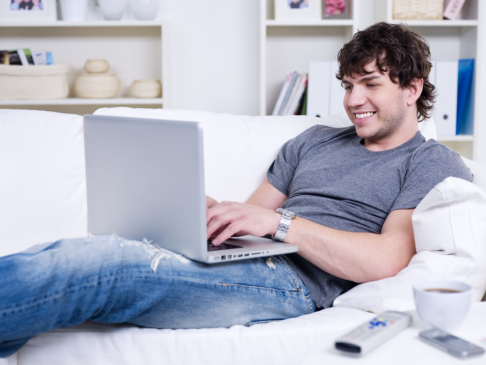 handsome-young-relaxing-man-using-laptop