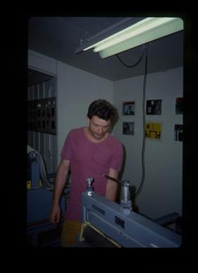Vladimir Kokolia using printing press