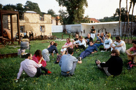 Artists sitting in the lawn at Ales Vesely's studio