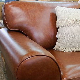 Brown leather lounge