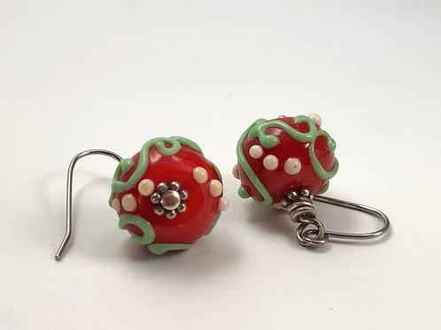 Green swirl on red earrings