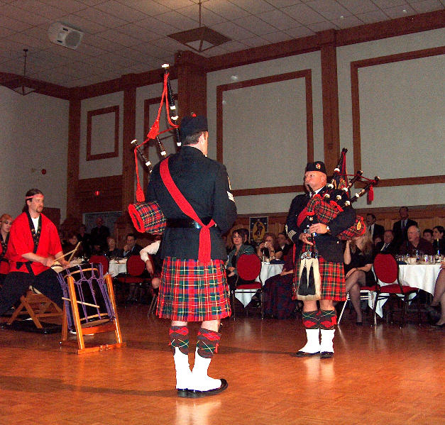 P/M McKee and Pipe Sgt. Hilton playing with the Japanese Drum Line in 2006