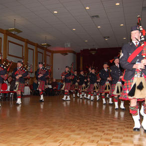 The band shows their marching and piping skills