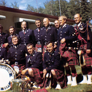 "Rocky Mountain House, July 1971.Back row R. to L., P/M John Izatt, W. Anderson, H. Palmer, D. Osberg, D. Scott, J. Philips, P. Demers, unknown, B. Hanna. Front row R. to L., B. Boyd, Abe Drynan, Bob ""Duke"" Evans, F. Cockerham,B. McKnight."