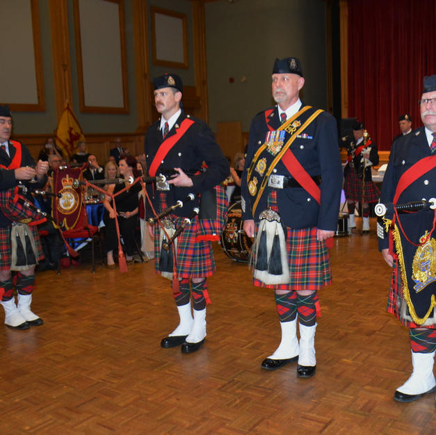 Pipe Major McKee, Drum Major Lange and Pipe Sgt. McDonald (r. to l.)