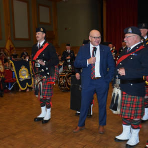 Chief Dale McFee congratulating PM McKee on his 36 years as Pipe Major