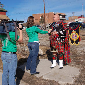 Pipe Major McKee being interviewed by local media just before the parade
