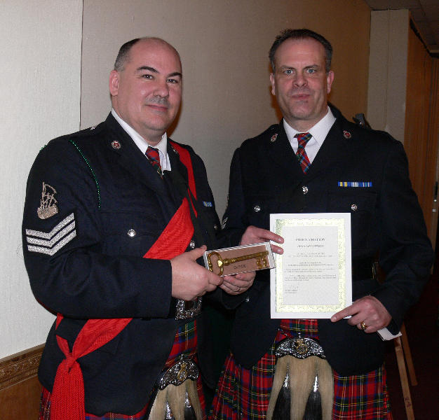 Pipe Sgt. Nick Perry & Band Officer Terry Rocchio with Key to the City and Honorary Butte Citizen Certificates