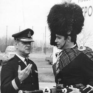 Pipe/Major David Scott with General John DeChastilane during the Airborne Regimental Trooping of the colors, Sept., 1977.