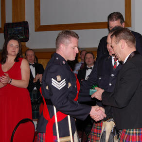 Drum Sgt. James McLeod receives an award from the band