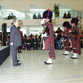 Drum Major Lange saluting the Honourable Donald S. Ethell, Lieutenant Governor of Alberta