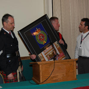 Butte Silverbow Chief Executive Officer Paul Babbs accepting on behalf of Butte a 25 year presentation by Band Officer Terry Rocchio & Drum Sgt. James McLeod