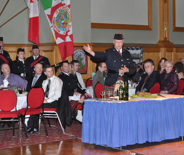Retired S/Sgt. Kevin Quail addresses the haggis in 2011