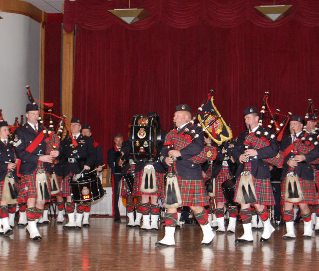 The pipers join the drummers