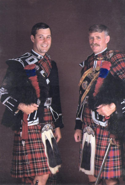 Pipe Major Dave Scott and Drum Major P.J. (Paddy) Bawn in July 81