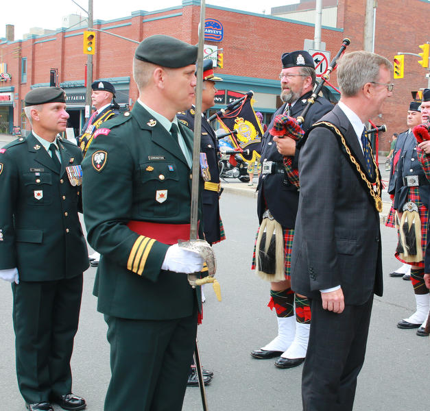 Guest Piper Murdoch (Doc) Jardine being inspected at Ottawa City Hall.