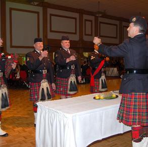 Ret. S/Sgt. Quail toasts the Haggis