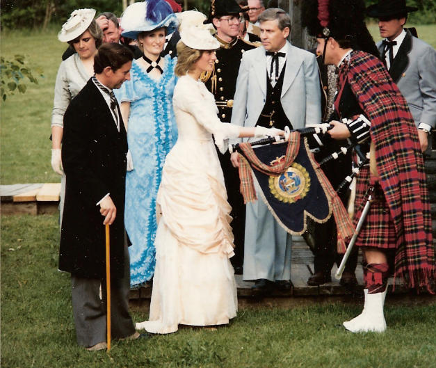 P/M David Scott being presented to H.R.H. The Prince of Wales & H.R.H. The Princess of Wales prior to piping them to dinner at Fort Edmonton Park, 29 June, '83. Mayor C.J. Purves in background.