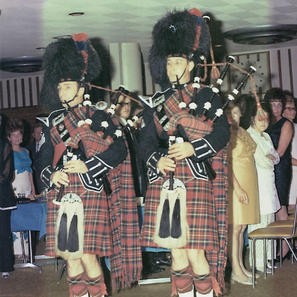 Pipe/Sgt. Harry Palmer and Piper David Scott playing for the Annual Police Ball, Lister Hall, Nov. 1970.