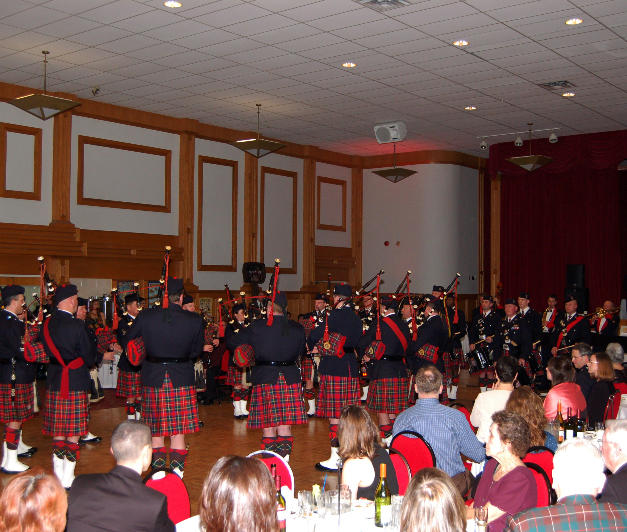 The whole band plays with members of the Canadian Artillery Band