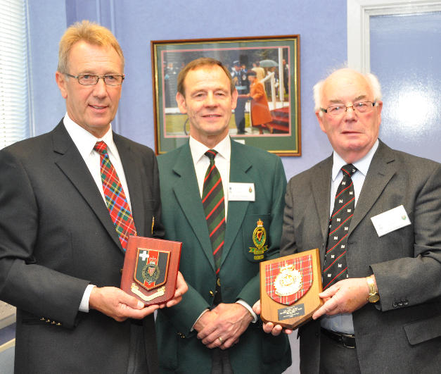 Exchanging plaques with members of the RUC George Cross Foundation