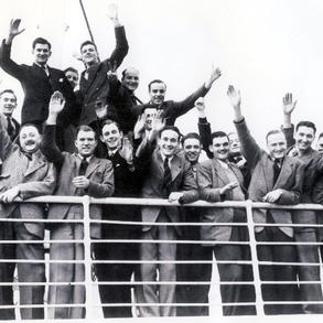 Royal Ulster Constabulary members on a ship as they emigrated to Canada in 1952 to join Edmonton Police Force