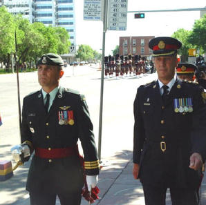 D/Chief Mike Bradshaw on right at the 90th Anniversary of PPCLI parade in Edmonton July 2004