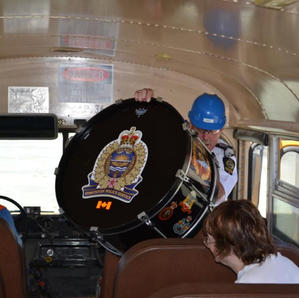July 4 2012 Drum Major Lange squeezing onto the bus at the mine
