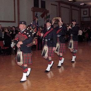 Pipe Major McKee pipes in the Haggis in '06