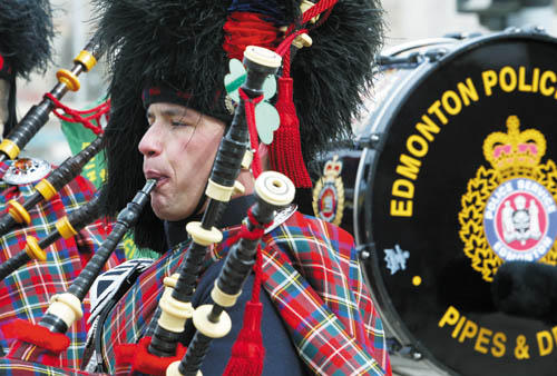 Members of the Edmonton Police Service Pipes and Drums play during the St. Patrick's Day parade Monday in Uptown Butte. (photo by Derek Pruitt/The Montana Standard)