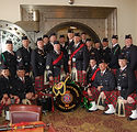 Pipes and Drums infront of the safe at the Metals Bar in Butte