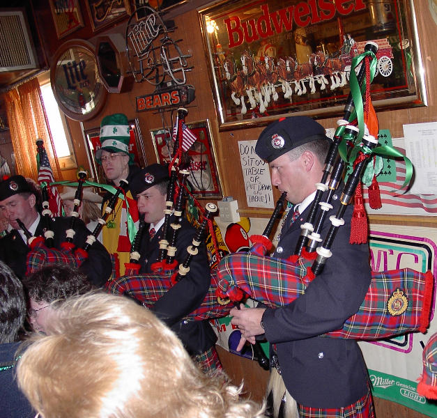 Pipers playing at Sam's Place in 2003