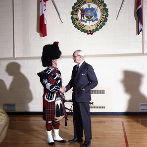 EPS Pipes and Drums receives the PPCLI badge to wear on their uniform in February 1972 PM John Izatt