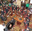 Pipe Band playing at a bar for St Patrick's Day in Butte