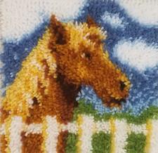 horse behind a gate