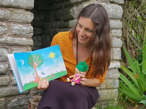 Celine_reading_Strong_Mind_Dzogchen_for_Kids_Thoughts_Like_a_Tree_2.JPG