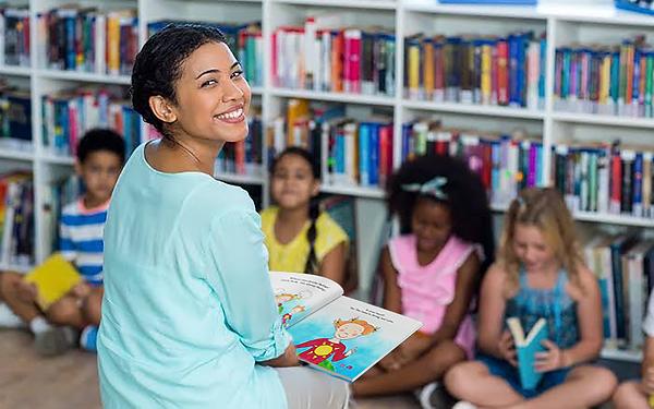 Books_In_Teacher_Hand.PNG