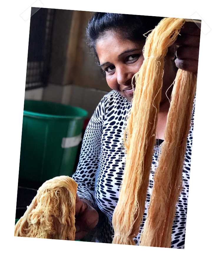 A woman working for Amma in Sri Lanka is dyeing fabrics.