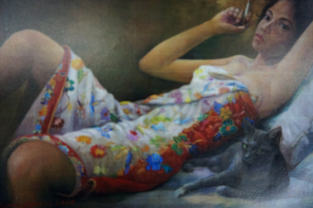 Painting of an Orang Asli girl smoking