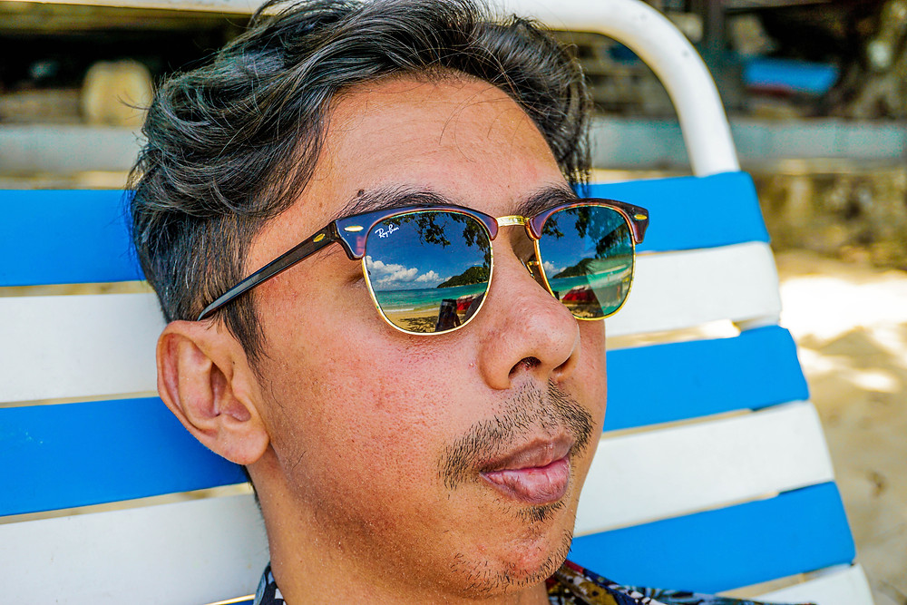 Navvin at the beach with sunglasses