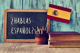 a chalkboard with the question hablas es