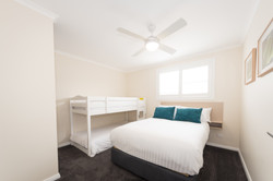 Double bed and bunks in bedroom 2