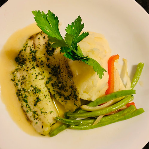 Baked tilapia with mashed potatoes lemon butter sauce and green bean medley