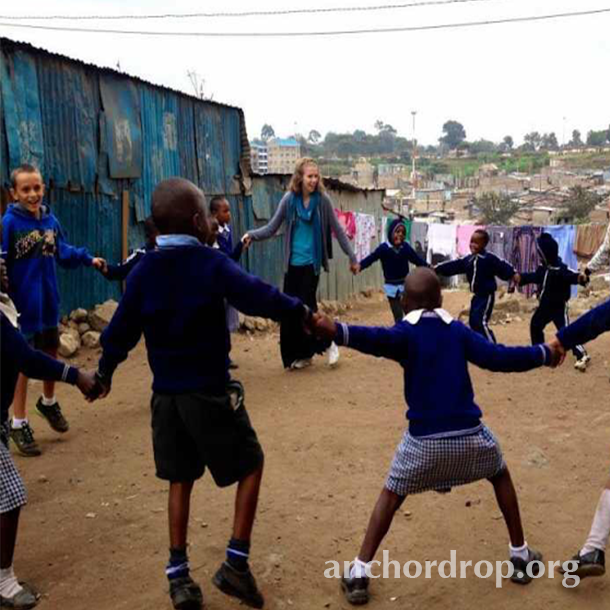 The author playing in a circle with Kenyan children