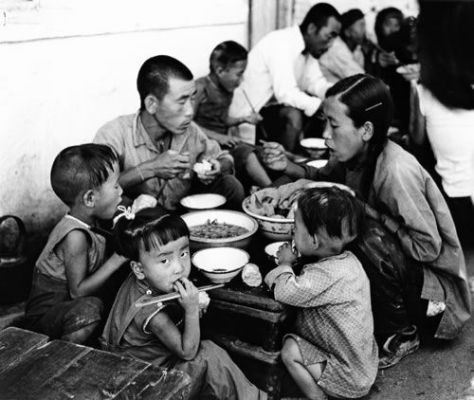 Black and white photo of family eating together