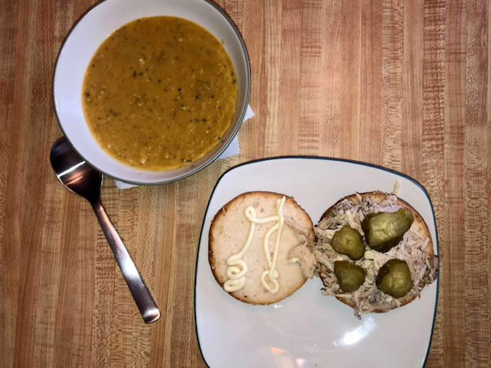 Finished soup with a sandwich