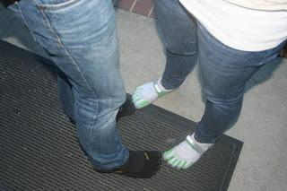 Two women wearing barefoot shoes
