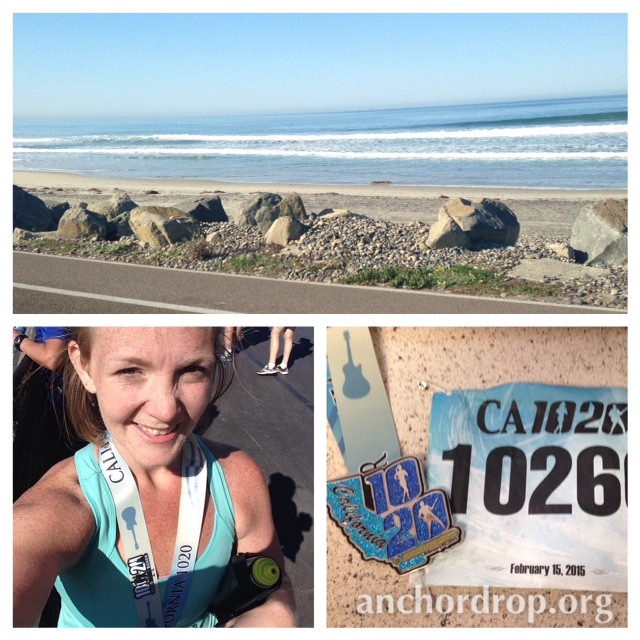 the ocean and a girl wearing a half marathon medal