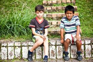 to children sitting on an outdoor stairway